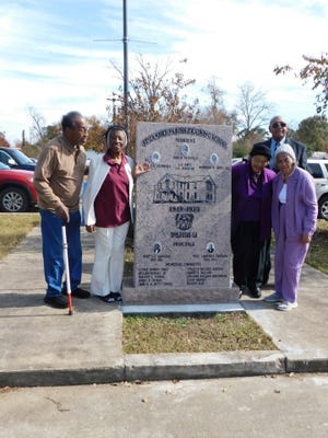 Students from the Opelousas-St. Landry Training School and former faculty member Regina Tatum gather around a historic marker that was dedicated last week at the site of the first African-American high school which was located at the corner of Vine and Academy streets in Opelousas.
