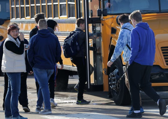 Students are evacuated from the scene of an officer-involved shooting at Oshkosh West High School after an armed student confronted a school resource officer on Tuesday, Dec. 3, 2019, at Oshkosh, Wis.