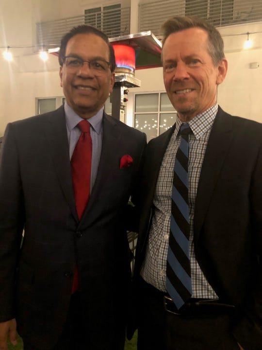 Raju Mehta shares a moment with Greg Murphy.
