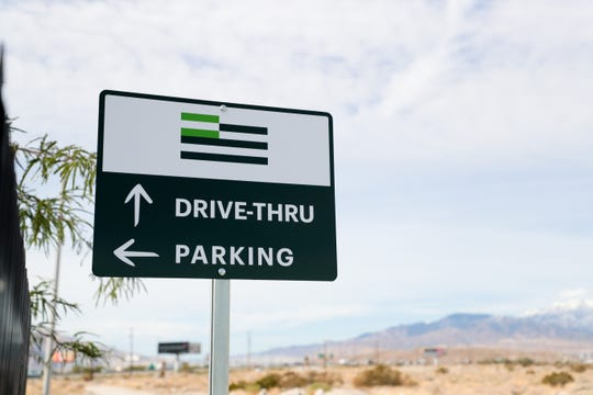A sign direct drivers to parking and the drive-thru at Harborside dispensary's newest location on Monday, December 2, 2019 in Desert Hot Springs, Calif.