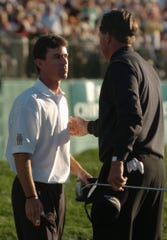 Skip Kendall, left, talked to Phil Mickelson after Mickelson won a one-hole playoff in the 2004 Bob Hope Chrysler Classic at PGA West in La Quinta. Mickelson won the tournament trophy and $810,000 prize. Kendall came in second place.