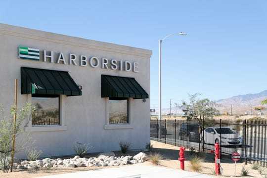 A sign for Harborside's newst dispensary sits on the building on Monday, December 2, 2019 in Desert Hot Springs, Calif.