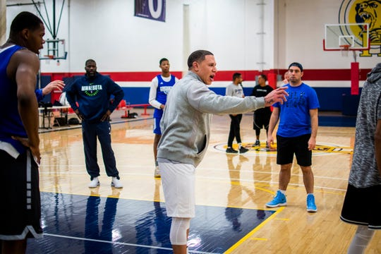 Hillcrest Prep coach Mike Bibby goes over plays with his team during a practice Dec. 2 at Inspire Courts.