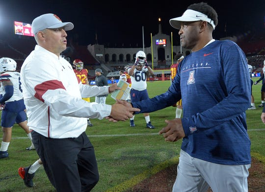 USC head coach Clay Helton and Arizona head coach Kevin Sumlin have major questions surrounding their programs.