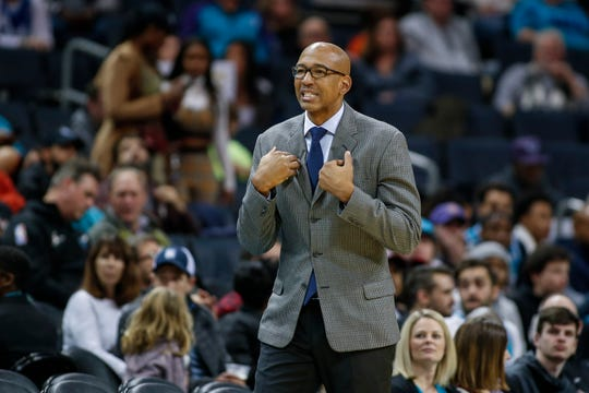 Phoenix Suns coach Monty Williams watches his team play against the Charlotte Hornets in the second half of an NBA basketball game in Charlotte, N.C., Monday, Dec. 2, 2019.