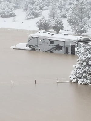 Rescuers save three people in a fifth wheel trailer in Yavapai County after floodwater rose up from a winter storm.