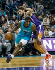 Charlotte Hornets guard Dwayne Bacon (7) drives past Phoenix Suns guard Ty Jerome (10) in the second half of an NBA basketball game in Charlotte, N.C., Monday, Dec. 2, 2019.