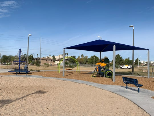 The shaded playground and walking path at Mesa's new Eagles Park.