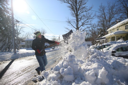 Laura Tyler and Pete Mauney shovels their driveway in Tivoli on December 3, 2019.