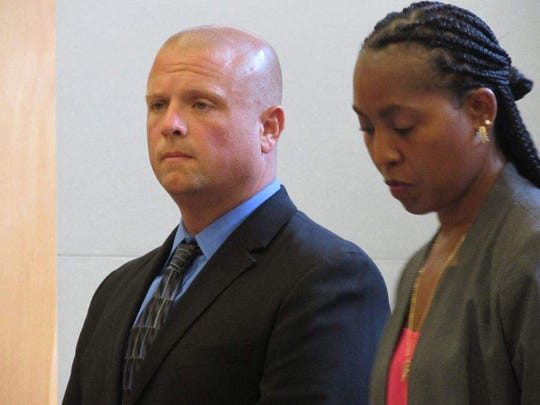 Gregg Marinelli of Plattekill, shown here with lawyer Renee Hill at an August appearance in Orange County Court, pleaded guilty on Monday to second-degree criminal possession of a weapon and second-degree hindering prosecution, felonies.
