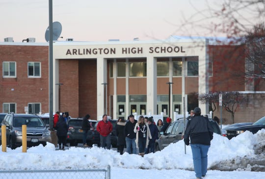 Parents are turned around by law enforcement from Arlington High School following a lock down on December 3, 2019.