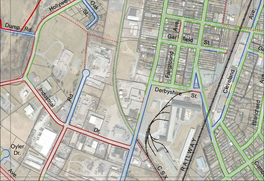 This image shows the F2 block on the Borough of Chambersburg's proposed sidewalk installation map. The thin red lines indicate property owners must install sidewalks along Industrial Drive, part of Progress Road, and Hollywell Avenue. The blue lines indicate sidewalks are not required, and the green lines mean sidewalks are already installed and are required.