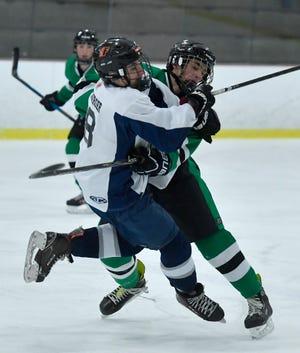 Dallastown's Trae Schanberger, left, takes an open ice hit by Sam Wareham of the Keystone Kraken's, Monday, Dec. 2, 2019.John A. Pavoncello photo