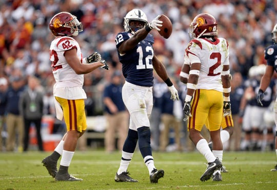 January 2, 2017; Pasadena, CA, USA; Penn State Nittany Lions wide receiver Chris Godwin (12) reacts after gaining yards on a catch against the Southern California Trojans during the first half of the 2017 Rose Bowl game at the Rose Bowl. Mandatory Credit: Gary A. Vasquez-USA TODAY Sports
