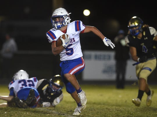 Reno's Drue Worthen runs while taking on Reed during their football game in Sparks on Oct. 18, 2019.