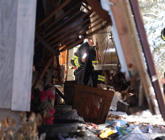 Macedon Fire Marshal Jeremiah Shufelt looks over the wall that was blown out from the furnace explosion in a Wilcox Road home in Macedon on Dec. 3, 2019.