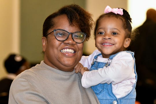 Chelsea Hawkins, left, holds her daughter Skylar Smith. Chelsea is a program specialist at AgeOptions.