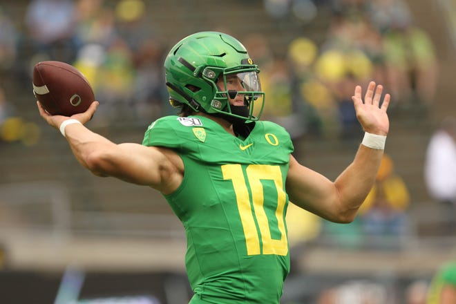 Sep 7, 2019; Eugene, OR, USA;  Oregon Ducks quarterback Justin Herbert (10) throws the ball during before playing Nevada Wolf Pack at Autzen Stadium. Mandatory Credit: Jaime Valdez-USA TODAY Sports