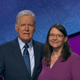 "Davita Curtis, a Salem resident, posing with ""Jeopardy!"" host Alex Trebek. Curtis will be featured as a contestant on the game show Wednesday, Dec. 4."