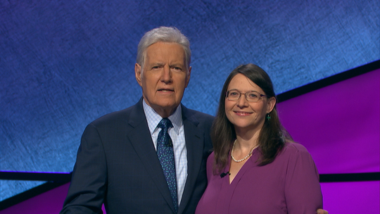"""Davita Curtis, a Salem resident, posing with """"Jeopardy!"""" host Alex Trebek. Curtis will be featured as a contestant on the game show Wednesday, Dec. 4."""