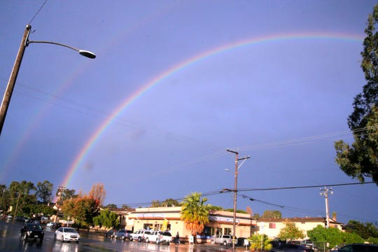 A rainbow appears as dusk nears during a day of downpours in Salinas Dec. 2, 2019.