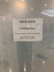 "A sign at the previous site of Payless reads ""Shoe Show: Coming Soon."""