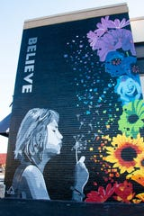 "The ""Believe"" Mural is on East Market Street on the side of the Delmarva Veterans Builders building in Salisbury.  Brandon Bell and Deserea Martin. The girl in the photo is Addison, the couple's daughter. It was completed in 2019."