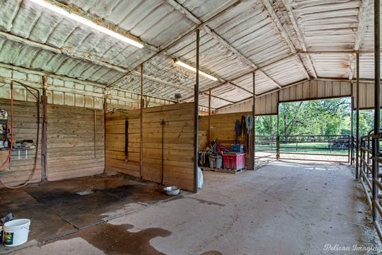 A multiple stalled horse barn, cleaning stations and holding pens makes this property a horse lover's dream.