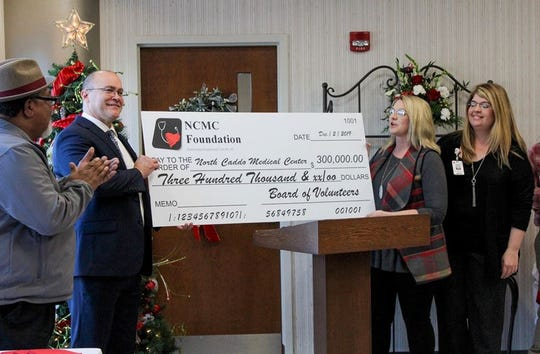 David Jones, CEO of North Caddo Medical Center, accpets a check from the North Caddo Medical Center Foundation to use toward the remaining amount of the MRI machine purchase.