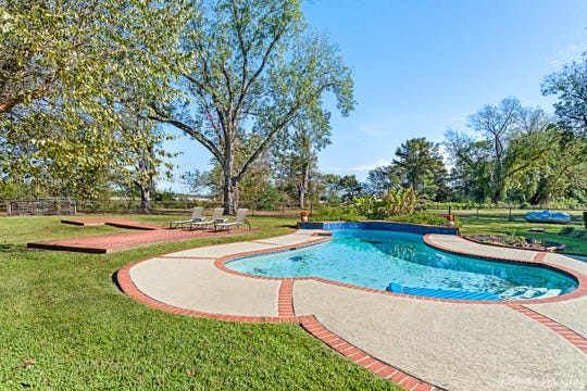 Outdoor entertaining is easy with the inground pool and brick deck.