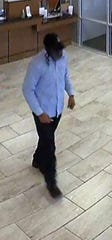 Suspect wearing a fake beard and wig is seen on surveillance at Barksdale Federal Credit Union.