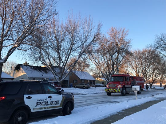 Crews are on scene the morning after a fatal house fire in western Sioux Falls on Tuesday morning. One person died in the fire Monday night.