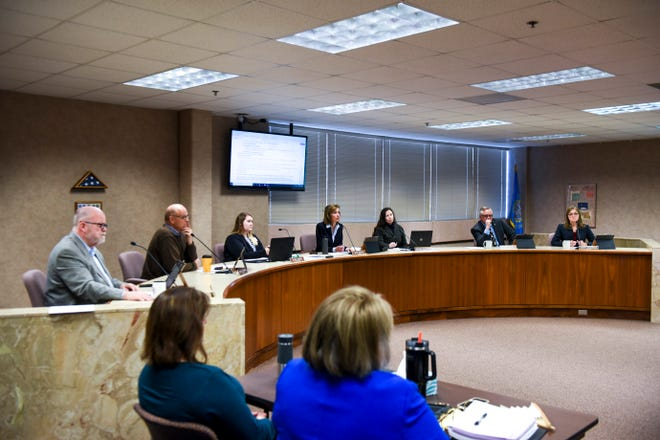 Minnehaha County Commission unanimously approves the motion to accept the resignation of State's Attorney Aaron McGowan on Tuesday, Dec. 3, 2019 in Sioux Falls, S.D.