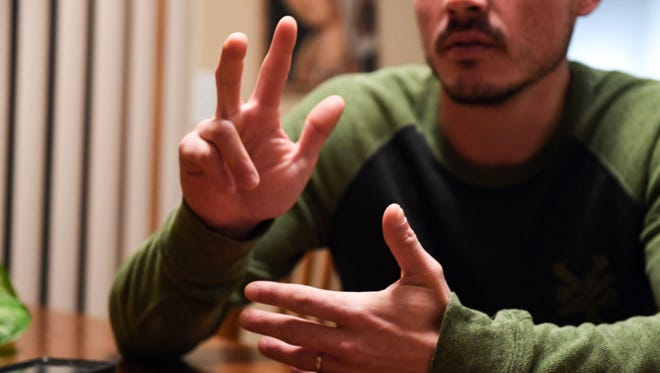 Taner Kiewel, right, has a conversation with his mother, Julie Huggins, in American Sign Language on Monday evening, Nov. 11, at Huggins' home in Sioux Falls.