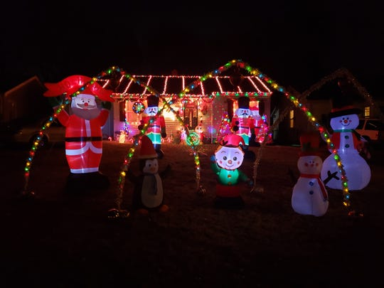 Juanita Perkins' home at 2132 N. Fort Ave. is a wonderland with colorful arches and a festively lit house.