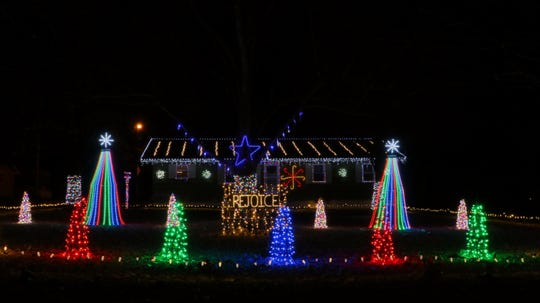 Cole Underwood's display at 7820 W. Farm Road 168, Republic, features 10 Christmas trees with more than 11,500 lights synchronized to music.