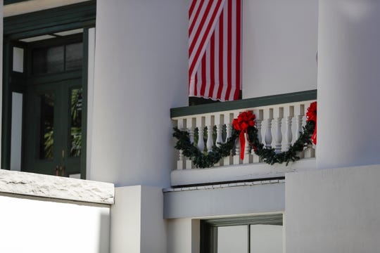 Holiday garland is draped over the railings of the Florida Historic Capitol Tuesday, Dec. 3, 2019.