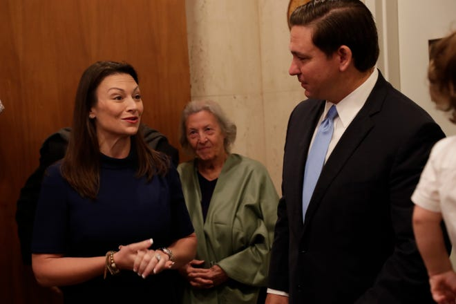 Agriculture Commissioner Nikki Fried presents Gov. Ron DeSantis with a Florida-grown Christmas tree, placed in the lobby of the governor's office Tuesday, Dec. 3, 2019.