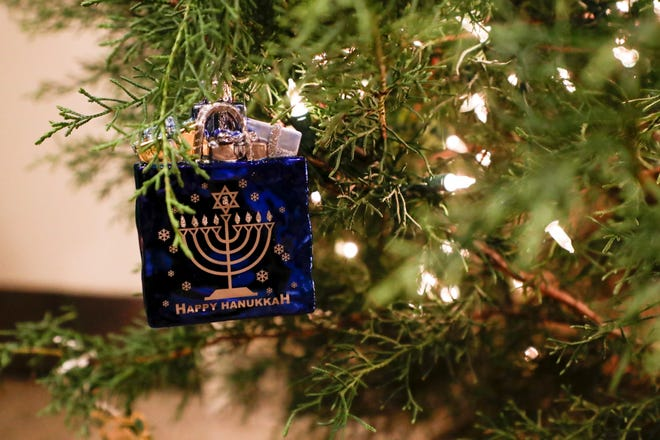 A 'Happy Hanukkah' ornament is one of two of the first ornaments placed on the Florida governor's Christmas tree presented on Dec. 3, 2019.