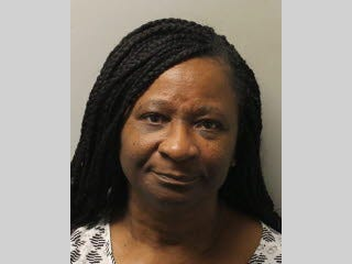 Lenora Fluellen, 64, was arrested on a warrant Monday and charged with keeping a gambling house and 122 counts of possession of a slot machine.