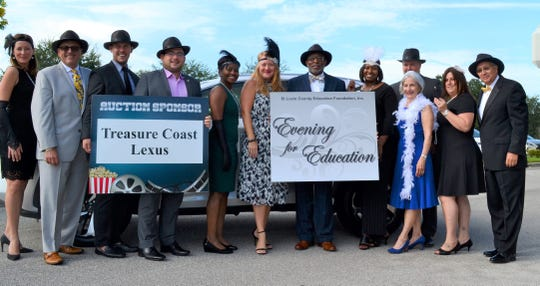 The St. Lucie County Education Foundation's 20th annual Evening for Education, featuring a Roaring 20's theme, was attended by, from left, Kate Cotner, Leonard Villafranco, Dean DeVries, Anthony Bonna, Makeda Brome, Dr. Kevin Perry, Shrita Walker, Ron Pietkewicz, Elizabeth Mallonee, Carissa Vega and Thom Jones.