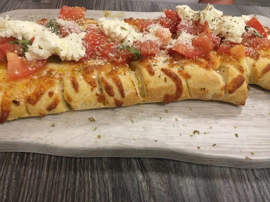 State Stix, Francesca'shomemade cheesy bread with a wide range of toppings, is served with a side of their yummy marinara sauce.