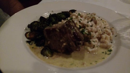 Savor's filet in a luscious béarnaise sauce is served with Brussel sprouts perfectly charred, and addictive truffle mac and cheese.