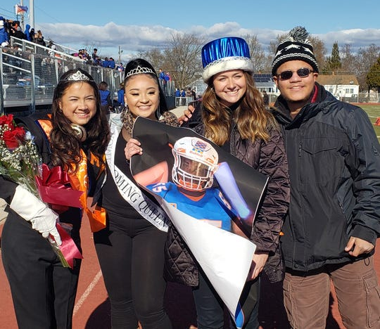 (From left) Maia Morales, Millville High School's 2019 Homecoming Queen, who was crowned by Alize Wilson, 2018 Homecoming Queen, and Brianna Miller, Tyrell Dunn's escort, who accepted the Homecoming King crown on his behalf from Ralph Martin, 2018 Homecoming King.