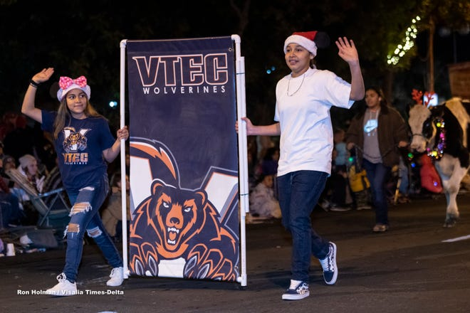 VTEC High School students parade down Main Street during the 74th annual Candy Candy Lane parade in Downtown Visalia on Monday, December 2, 2019.