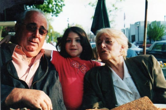 Andrea Luongo as a child and her parents.