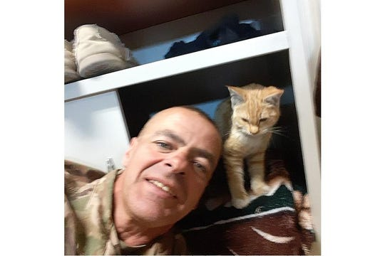 Dan Brissey, of Seaford, and his pal Sully in his bunk in Kabul, Afghanistan.