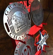 Examples of the custom barbeque grill grates and metal signs created by The Burn Shop. The business is relocating to downtown Wichita Falls at 815 Ohio.