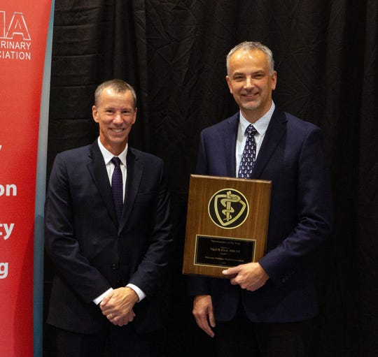 Wisconsin Veterinary Medical Association presented Dr. Nigel Cook, right, with the 2019 WVMA Veterinarian of the Year.. Also pictured is WVMA President-Elect Dr. Thomas Bach.