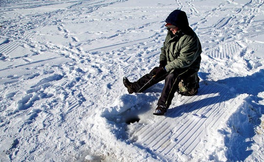 """The """"try to keep warm"""" approach to ice fishing on Lake Monona Bay in Madison, Wisconsin."""
